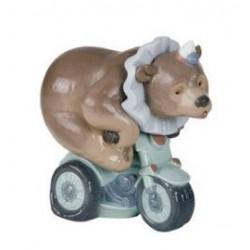 statuina cane su moto